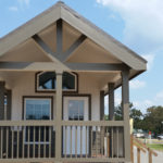 Home comes standard with pentazoid window in front. Model has been upgraded to include a 10' covered porch on the front.